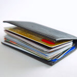 Carrying Too Much Credit, Wallet Stuffed With Cards